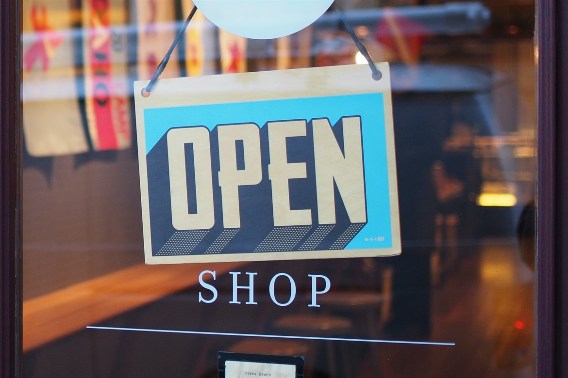 shop sign showing that they are open